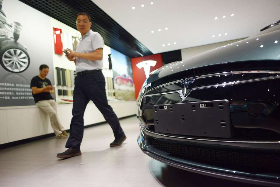 Tesla, which began selling the Model S in China in April, has settled with a businessman who challenged its rights to the name. Photo: Wang Zhao, AFP/Getty Images
