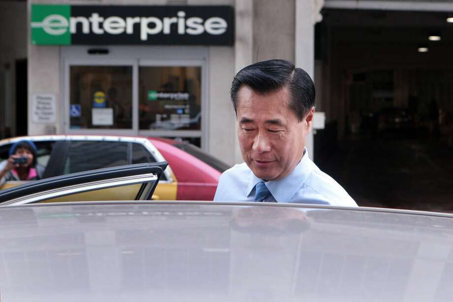 Suspended state Sen. Leland Yee gets into a car Thursday outside federal court in San Francisco. Photo: Kevin N. Hume, The Chronicle