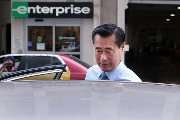 Former state Sen. Leland Yee gets into a waiting car outside the Phillip Burton Federal Courthouse after a hearing on expanded indictment charges including racketeering and various counts of corruption, money laundering and trafficking in weapons and drugs on Thursday, August 7, 2014 in San Francisco, Calif.