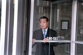 Former state Sen. Leland Yee leaves the Phillip Burton Federal Courthouse after a hearing on expanded indictment charges including racketeering and various counts of corruption, money laundering and trafficking in weapons and drugs on Thursday, August 7, 2014 in San Francisco, Calif.