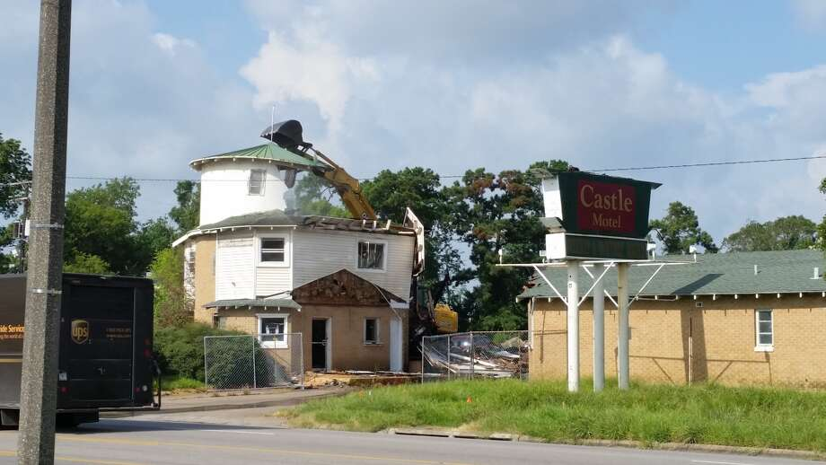 August 2: After multiple delays, Beaumont's Castle Motel is demolished.  Photo: Larry Mills