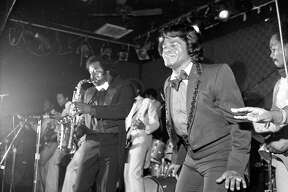 """James Brown performs at Fitzgerald's in Houston in 1985. Universal Pictures enlisted music-streaming service Pandora to promote Brown biopic """"Get on Up."""""""