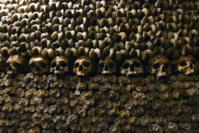 stack of skulls and bones of long-gone Parisians await visitors in ...