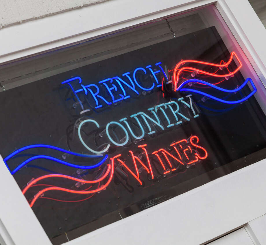 French Country Wines is hosting an art demonstration. Participants will learn about art projects using old wine labels. Photo: Craig Hartley, For The Chronicle / Copyright: Craig H. Hartley