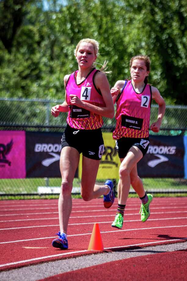 Staples' Hannah DeBalsi, right, runs behind Bethan Knights, of Irvine, Calif. during the 2-mile race at the Brooks PR Invitational held in Renton, Wash. last Saturday. Knights won the race and DeBalsi finished in second. Photo: Gary Paulson, Gary Paulson/Contributed Photo / Westport News Contributed