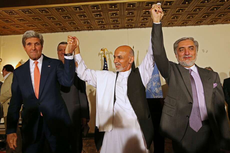 FILE - This July 12, 2014 file photo shows. from left, Secretary of State John Kerry, Afghanistan's presidential candidate  Ashraf Ghani Ahmadzai, and Afghan presidential candidate Abdullah Abdullah during  a joint news conference in Kabul, Afghanistan. The Obama administration on Thursday stepped up efforts to press Afghanistan's two feuding presidential candidates to end their dispute over June elections, accept the results of an ongoing audit of all ballots and form a national unity government by early September. On an unannounced visit to Kabul, Kerry made personal appeals to both candidates _ former Foreign Minister Abdullah Abdullah and former Finance Minister Ashraf Ghani Ahmadzai _ to understand the urgency of finding a resolution before the upcoming NATO summit in Wales on September 4, according to officials traveling with Kerry. (AP Photo/Rahmat Gul, File) Photo: Rahmat Gul, Associated Press