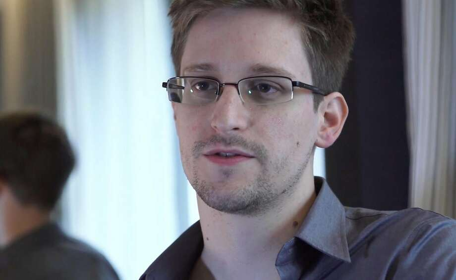 FILE - In this June 9, 2013 file photo provided by The Guardian Newspaper in London shows Edward Snowden, who worked as a contract employee at the National Security Agency, in Hong Kong. Former NSA systems analyst Edward Snowden, who is wanted by the U.S. for leaking details about once-secret surveillance programs, has been granted permission to stay in Russia for three more years, his lawyer said Thursday, Aug. 7, 2014. Snowden last year was granted temporary asylum of one year in Russia, but that ran out on Aug. 1. (AP Photo/The Guardian, Glenn Greenwald and Laura Poitras, File) Photo: Glenn Greenwald And Laura Poitra, Associated Press