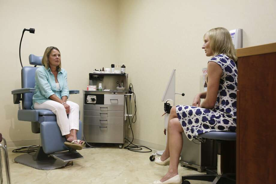 In this Aug. 1, 2014 photo, Louise Danzig, of Montauk, N.Y., left, discusses with Dr. Erin McGintee her progress after Danzig landed in the hospital because a tick bite gave her a severe allergic reaction to eating a burger last summer in East Hampton, N.Y. McGintee, an allergist, has seen nearly 200 cases where a bite by a Lone Star tick has triggered patients' immune systems to build antibodies against a certain sugar found in red meat. (AP Photo/Rachelle Blidner) Photo: Rachelle Blidner, Associated Press