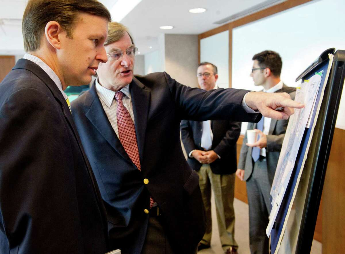 U.S. Sen. Chris Murphy speaks with Joseph McGee, Vice President of Public Policy and Programs for the Business Council of Fairfield County, who points to a map as they talk before Murphy spoke during a meeting on Thursday, August 7, 2014, at Landmark Square in Stamford, Conn., where he announced legislation he is sponsoring to fund major rail projects.