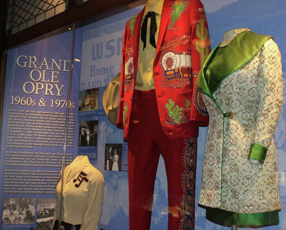 "A decade-by-decade timeline at the Ryman Auditorium features costumes, records and photos from the 100-plus-year history of ""The Mother Church of Country Music."" Photo: Karen-Lee Ryan / For The Express-News"