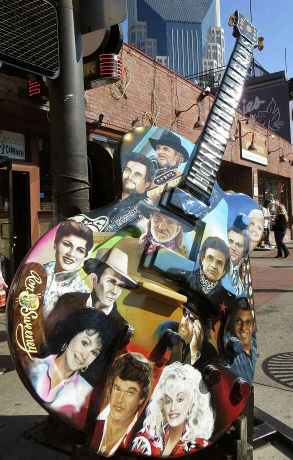 Johnny Cash and Willie Nelson are among legends pictured on this lively piece of public art on Broadway in downtown Nashville. Photo: Photos By Robin Soslow / For The Express-News