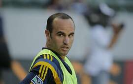In this Saturday, July 12, 2014 photo, Los Angeles Galaxy's Landon Donovan stretches before the team's MLS soccer match against Real Salt Lake in Carson, Calif. Donovan says he will retire from professional soccer at the end of the MLS season. (AP Photo/Jae C. Hong)
