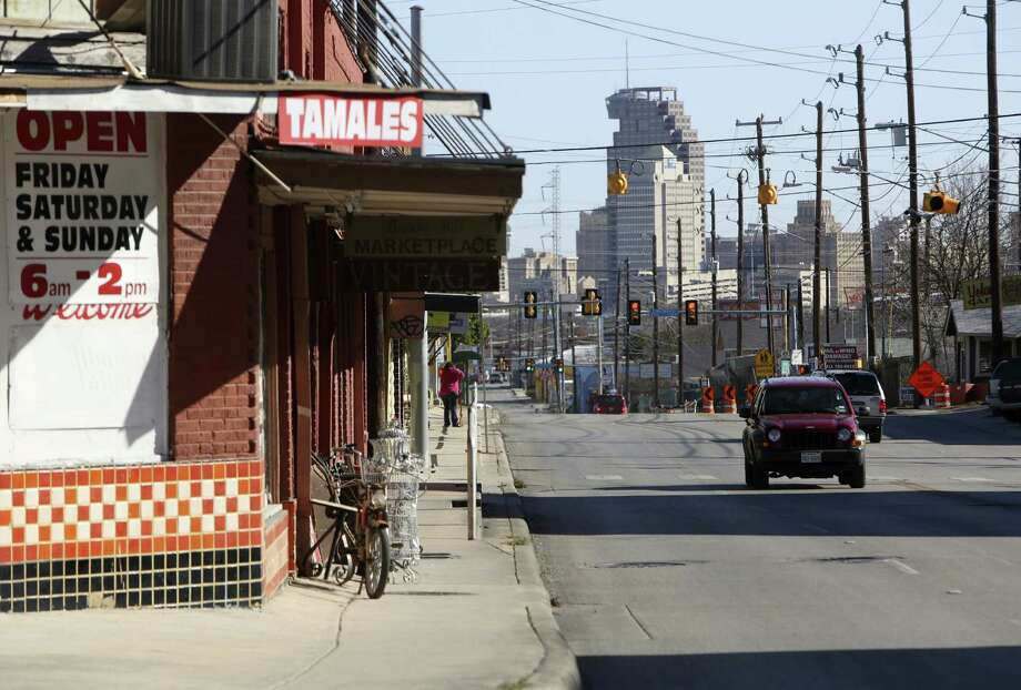 Downtown is visible from the corner of French Place and Fredericksburg Road in Beacon Hill. The city is committed to improving the quality of life without displacing residents in five central city neighborhoods. Photo: Express-News File Photo / ©2013 San Antonio Express-News