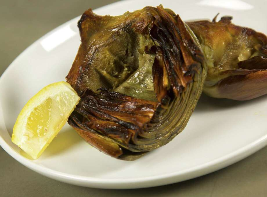 Artichoke:This edible thistle can be intimidating for the uninitiated. Photo: William Luther, San Antonio Express-News / © 2014 San Antonio Express-News