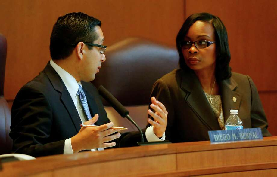 City Council member Diego Bernal, left, talks Thursday morning Aug. 7, 2014 in City Council Chambers with Mayor Ivy R. Taylor during presentations about the ongoing streetcar issue. Photo: William Luther, San Antonio Express-News / © 2014 San Antonio Express-News