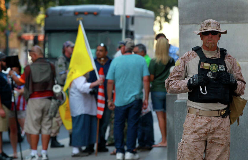 A group that calls itself Border Convoy stands Thursday August 7, 2014 outside of the Mexican Consul