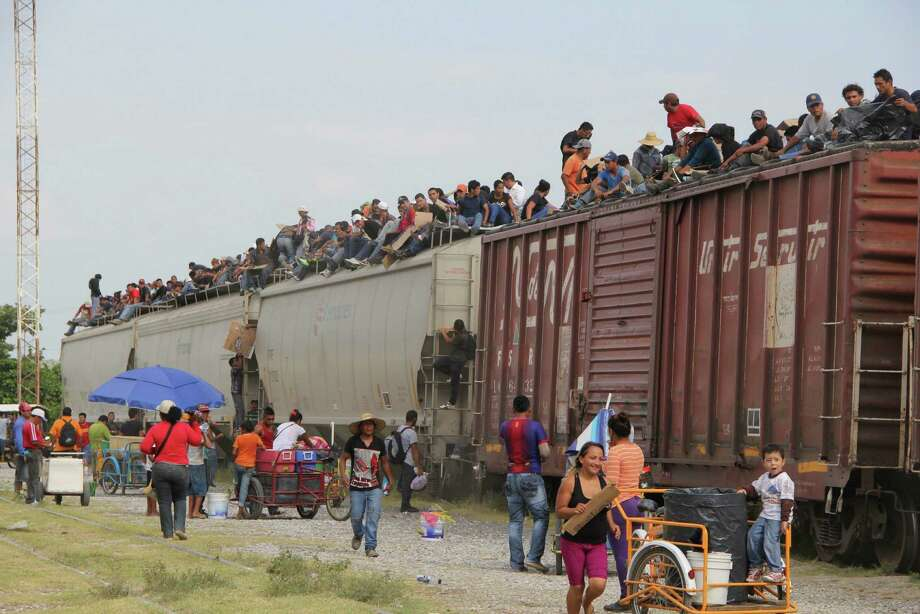 Migrants get on a cargo train in Arriaga, Mexico, last month in an attempt to reach the United States. Readers continue to debate the recent surge in immigrants. Photo: Elizabeth Ruiz / AFP / Getty Images / AFP