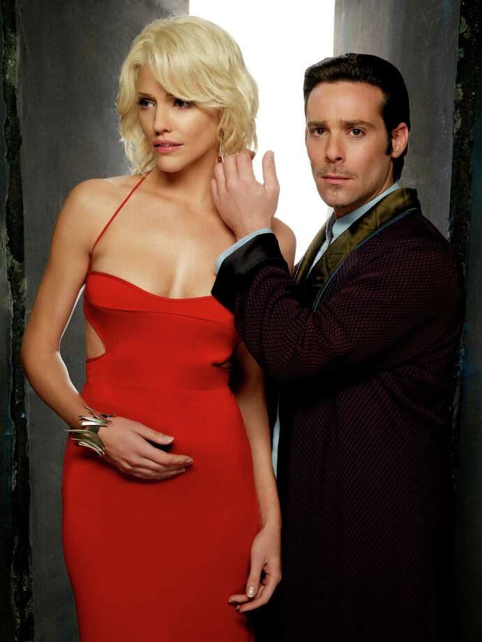 Tricia Helfer as Number Six, (left)Battlestar Galactica Photo: Syfy, Getty Images  / 2012 Syfy Media, LLC