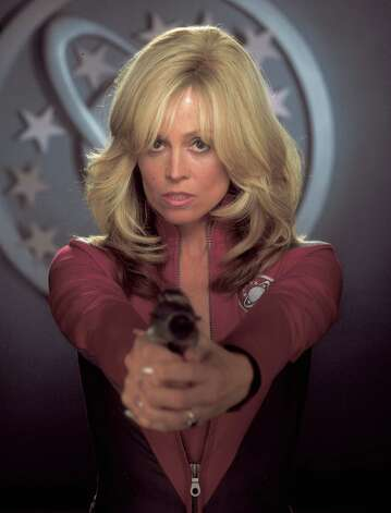 "'Galaxy Quest' - Decades after the success of the sci-fi series ""Galaxy Quest,"" the show's washed-up stars -- Jason Nesmith (Tim Allen), Gwen DeMarco (Sigourney Weaver) and Alexander Dane (Alan Rickman) -- are recruited by actual aliens to pull off an intergalactic rescue mission. At first, the actors assume the so-called Thermians are just another group of die-hard fans. But as the plot thickens, they realize they're working with real-life extraterrestrials. Available Oct. 1 Photo: Murray Close, Getty Images / 2011 Murray Close"
