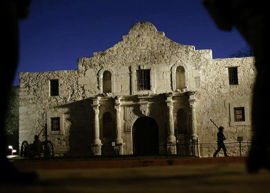 Dan Phillips, a member of the San Antonio Living History Association, patrols the Alamo during a 2013 pre-dawn memorial ceremony to remember the 1836 Battle of the Alamo. Photo: Associated Press File Photo / AP