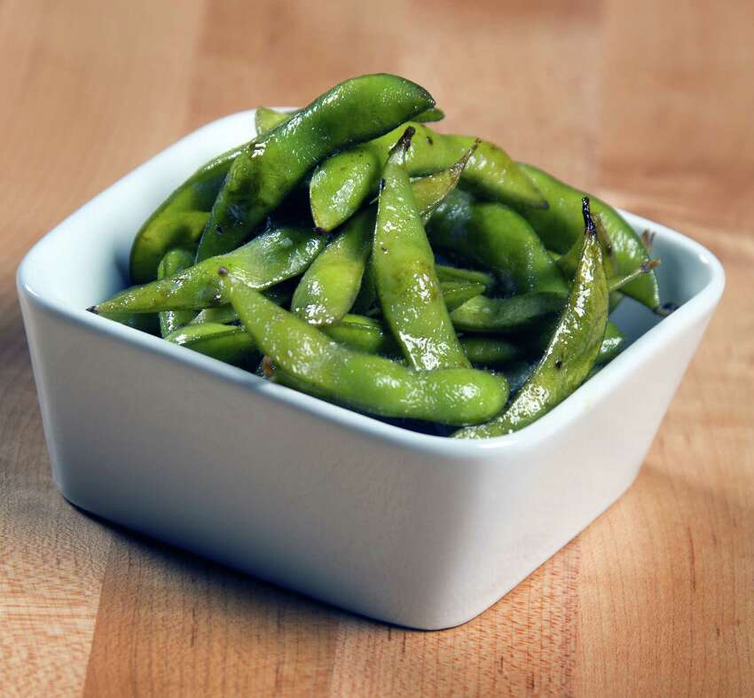 Edamame: Eat edamame by putting the whole pod in your mouth, and then pull out the seeds with your teeth.