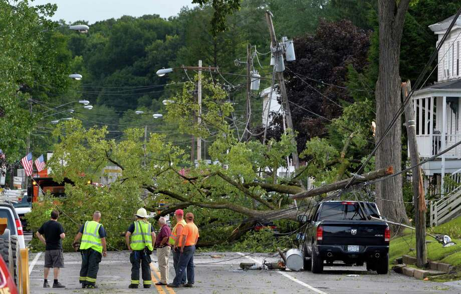 Downed power lines closed Broad Street in Schuylerville after they were taken down by a fallen tree following storms Thursday evening, Aug. 7, 2014, in Schuylerville, N.Y. (Skip Dickstein/Times Union) Photo: SKIP DICKSTEIN