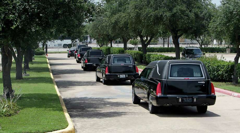 Five hearses exit the Charismatic Catholic Church after the funeral for Valentin Guzman, 41, his 40-year-old wife, Elvira Guzman-Santoyo, and four of their children were killed while driving to Oklahoma on June 29th when they were struck by a truck traveling in the wrong direction on the north Sam Houston Parkway Thursday, Aug. 7, 2014, in Houston. Photo: James Nielsen, Houston Chronicle / © 2014  Houston Chronicle
