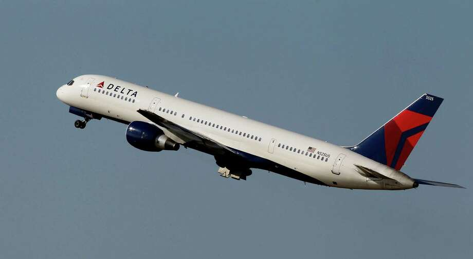 File-This photo taken Jan. 20, 2011, shows a Delta Airlines Boeing 757 taking off  in Tampa, Fla.  Delta Air Lines is making fundamental changes to its frequent flier program and will reward those who buy its priciest tickets, as opposed to those who fly the most miles. The airline said Wednesday, Feb. 26, 2014,  that the 2015 SkyMiles program will better recognize frequent business travelers and leisure customers who buy premium fares. (AP Photo/Chris O'Meara, File) ORG XMIT: NY114 Photo: Chris O'Meara / AP
