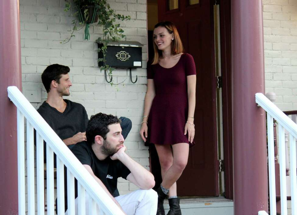 From left to right: actor Parker Young, left, director Andrew Nackman, center, and actress Jennifer Damiano, right, work on set while filming a scene from the movie