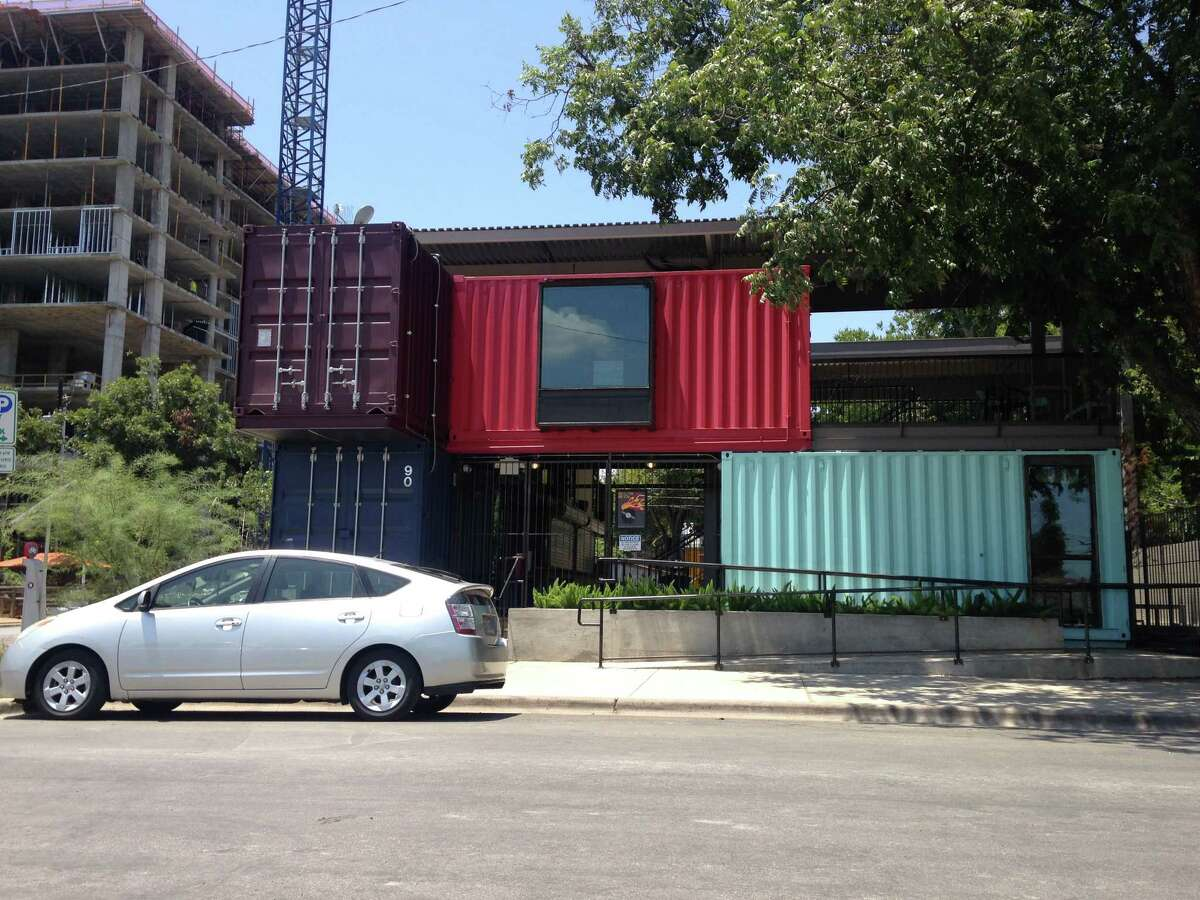 Each container at The Container Bar in Austin is painted a different color and has a different interior design.