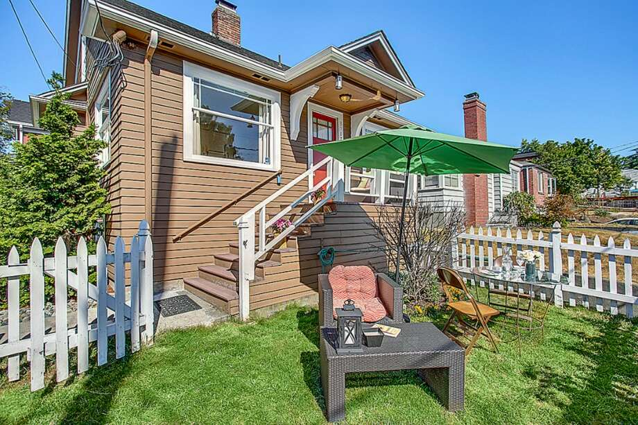 We'll start with the house priced closest to the July median, 3917 Midvale Ave. N., Unit A, which is listed for $549,950. The 2,140-square-foot house, built in 1926, has four bedrooms, two bathrooms and a family room on a 2,166-square-foot lot. An open house is scheduled for 1 p.m. to 4 p.m. on Sunday. Photo: HD Estates, Courtesy Trevor Smith/Locality