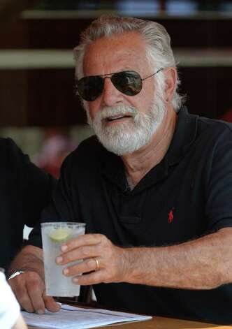 Actor Jonathan Goldsmith, otherwise known as The Most Interesting Man in the World according to his commercial appearances for Dos Equis beer, made a visit to the Saratoga Race Course Thursday afternoon, Aug. 7, 2014,  in Saratoga Springs, N.Y.  (Skip Dickstein/Times Union) Photo: SKIP DICKSTEIN
