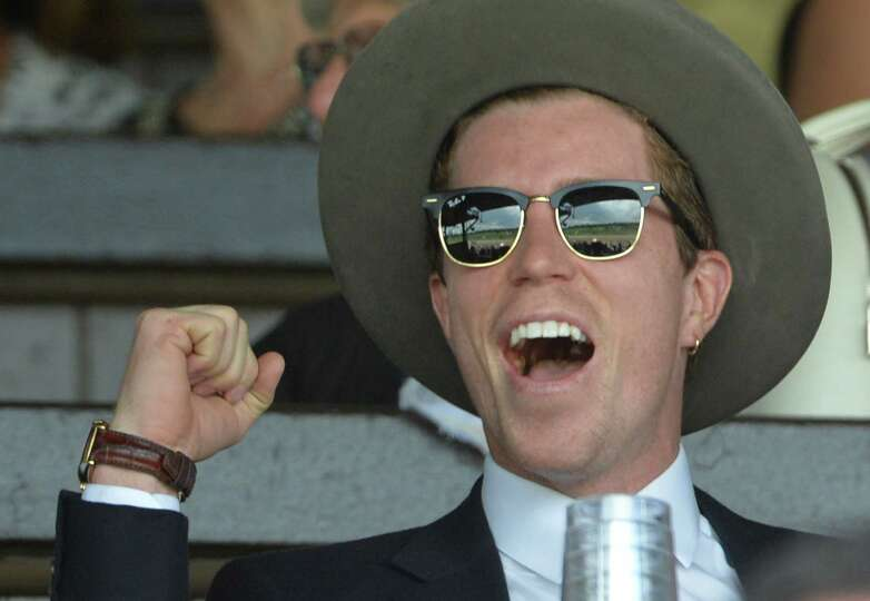 Olympic gold medalist Shawn White reacts to his winning wager in the 5th race at Saratoga Race Cours