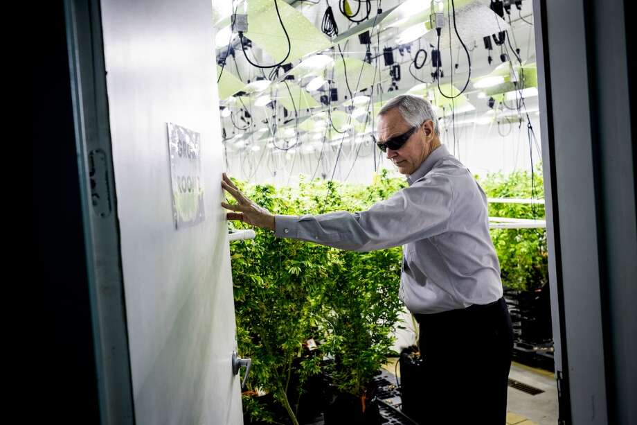 "Patrick Devlin, one of three co-owning brothers responsible for Seattle-based Db3 Corporation, provides a look inside of their 25,000 square-foot facility Thursday, Aug. 7, 2014, in Seattle, Wash. Db3 was the first company in the state to produce and process marijuana-infused edible products, such as baked goods, chews, energy drinks and drink additives - all under the brand name ""Zoots."" The edible products could make it onto store shelves as early as September 2014. (Jordan Stead, seattlepi.com) Photo: SEATTLEPI.COM"
