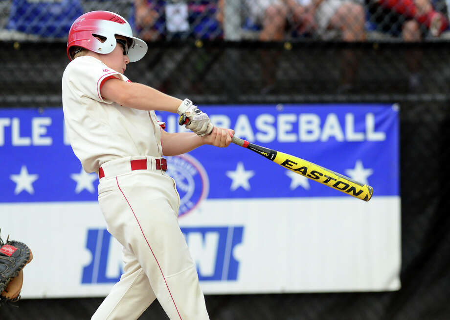Fairfield American's Jamie Flink hits a home run, during the New England Regional Little League semi-final action against Massachussetts in Bristol, Conn. on Thursday, Aug. 7, 2014. Fairfield went on to win the game 9-0 and will face Rhode Island in the series final on Saturday. Photo: Christian Abraham / Connecticut Post