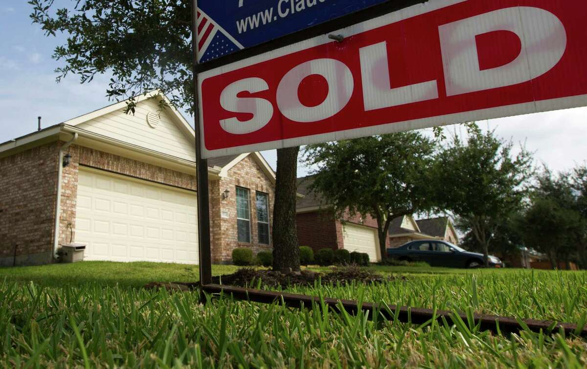 A house is sold in the Heritage Grand subdivision in Cinco Ranch on Thursday, July 31, 2014, in Houston. Only around 40 houses come up for sale a year in the 55& community. ( J. Patric Schneider / For the Chronicle )