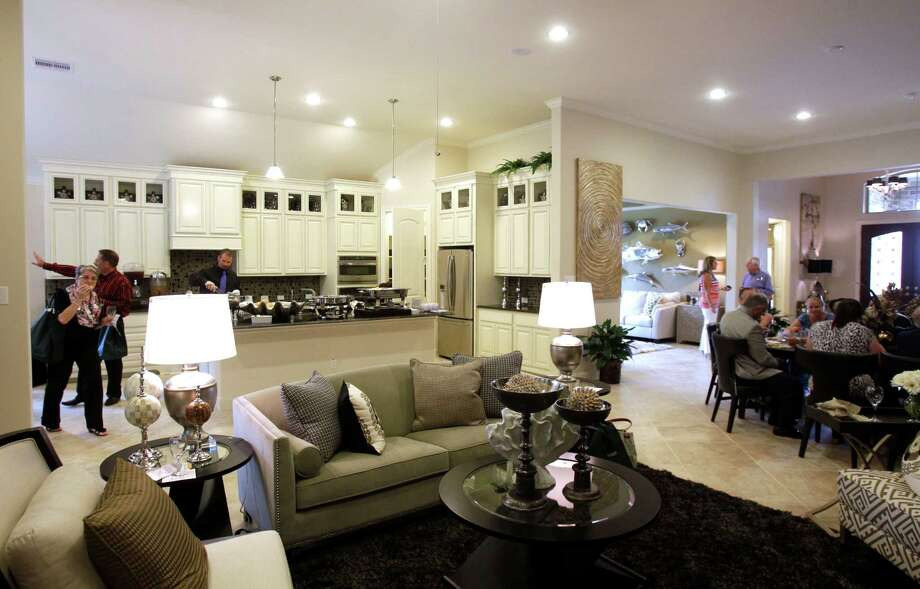 Houses for 55-plus buyers in Bonterra at Woodforest feature open living spaces. Real estate agents toured model homes there recently. Photo: Melissa Phillip, Staff / © 2014  Houston Chronicle