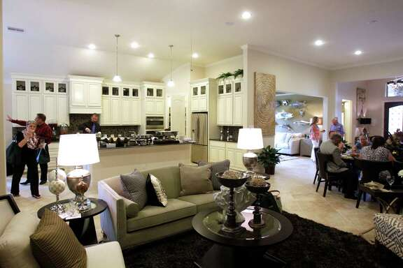 Houses for 55-plus buyers in Bonterra at Woodforest feature open living spaces. Real estate agents toured model homes there recently.