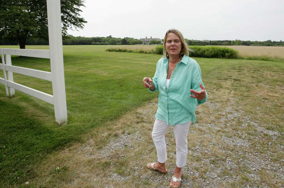 In this Aug. 1, 2014 photo, Louise Danzig, of Montauk, N.Y., stands in a field in East Hampton, N.Y., that is home to deer that may carry ticks that cause people to develop allergic reactions to red meat. Danzig landed in the hospital last summer after a tick bite caused her to go into anaphylactic shock from eating a hamburger. (AP Photo/Rachelle Blidner) ORG XMIT: NYRB103 Photo: Rachelle Blidner / AP
