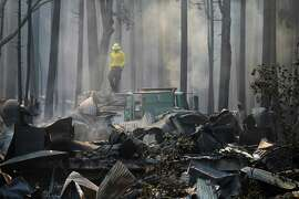 FILE - In this Aug. 26, 2013 file photo, a firefighter stands on top of a fire truck at a campground destroyed by the Rim Fire near Yosemite National Park, Calif. Keith Matthew Emerald was charged Thursday, Aug. 7, 2014 with starting the state's third-largest wildfire, a 2013 blaze that charred hundreds of square miles of land in Yosemite National Park and the Stanislaus National Forest. (AP Photo/Jae C. Hong, file) ORG XMIT: FX106