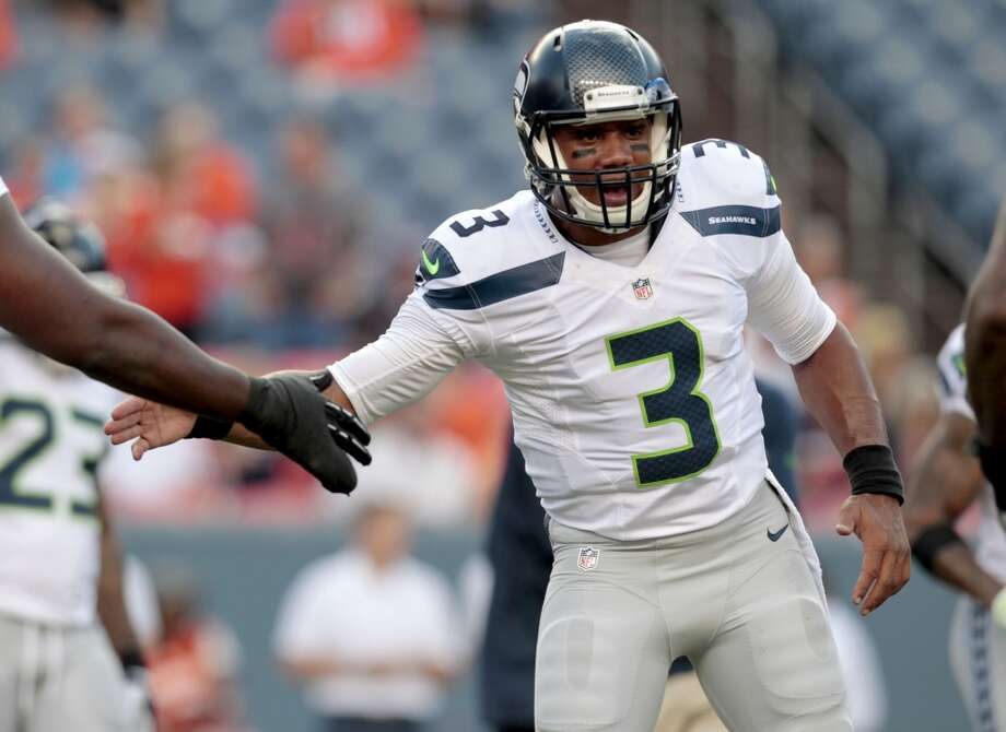 Seattle Seahawks quarterback Russell Wilson (3) takes the field prior to an NFL preseason football game against the Denver Broncos, Thursday, Aug. 7, 2014, in Denver. (AP Photo/Joe Mahoney) Photo: Joe Mahoney, AP