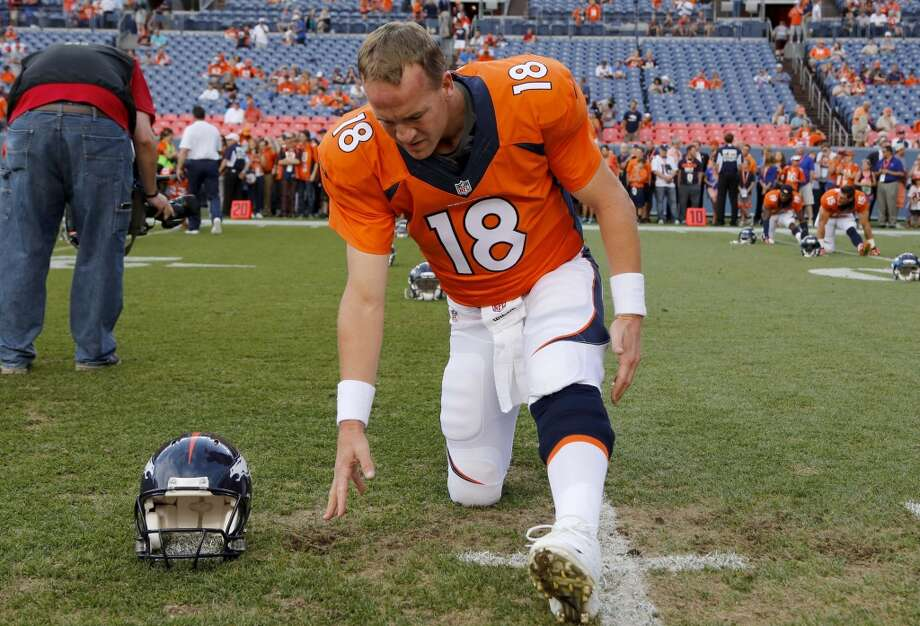 Denver Broncos quarterback Peyton Manning stretches prior to an NFL preseason football game against the Seattle Seahawks, Thursday, Aug. 7, 2014, in Denver. (AP Photo/Jack Dempsey) Photo: Jack Dempsey, AP