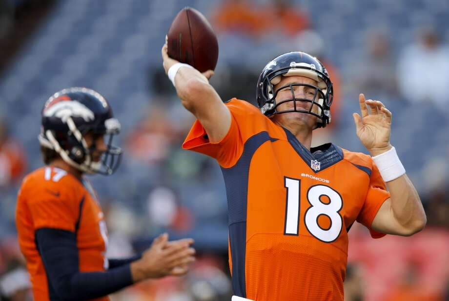 Denver Broncos quarterback Peyton Manning (18) warms up prior to an NFL preseason football game against the Seattle Seahawks, Thursday, Aug. 7, 2014, in Denver. (AP Photo/Jack Dempsey) Photo: Jack Dempsey, AP