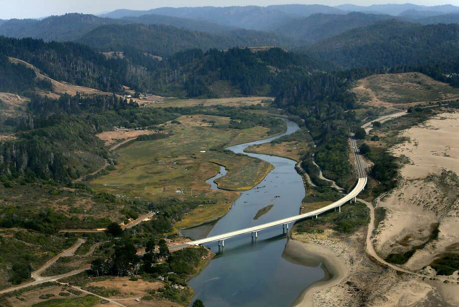 Ten Mile River estuary in rugged Mendocino County as it reaches the Pacific Ocean, with Highway 1 in the foreground. Photo: Michael Macor, The Chronicle