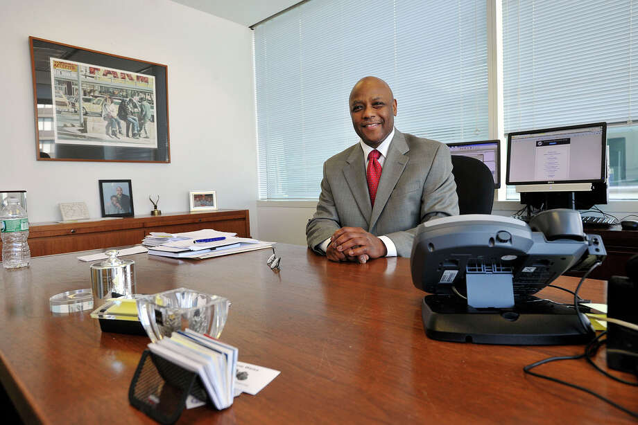 Michael Pollard poses for a photograph in his office at the Stamford Government Center in Stamford, Conn., on Thursday, Aug. 7, 2014. Pollard is the chief of staff to Mayor David Martin. Photo: Jason Rearick / Stamford Advocate