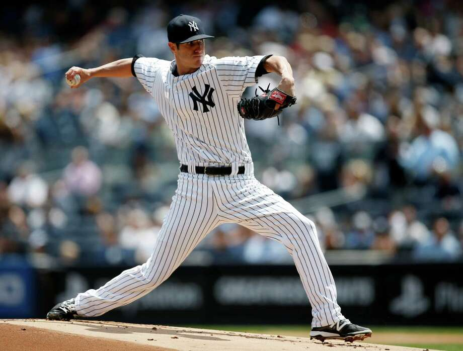New York Yankees starting pitcher Shane Greene delivers in the first inning of a baseball game against the Detroit Tigers at Yankee Stadium in New York, Thursday, Aug. 7, 2014.  (AP Photo/Kathy Willens) ORG XMIT: NYY106 Photo: Kathy Willens / AP