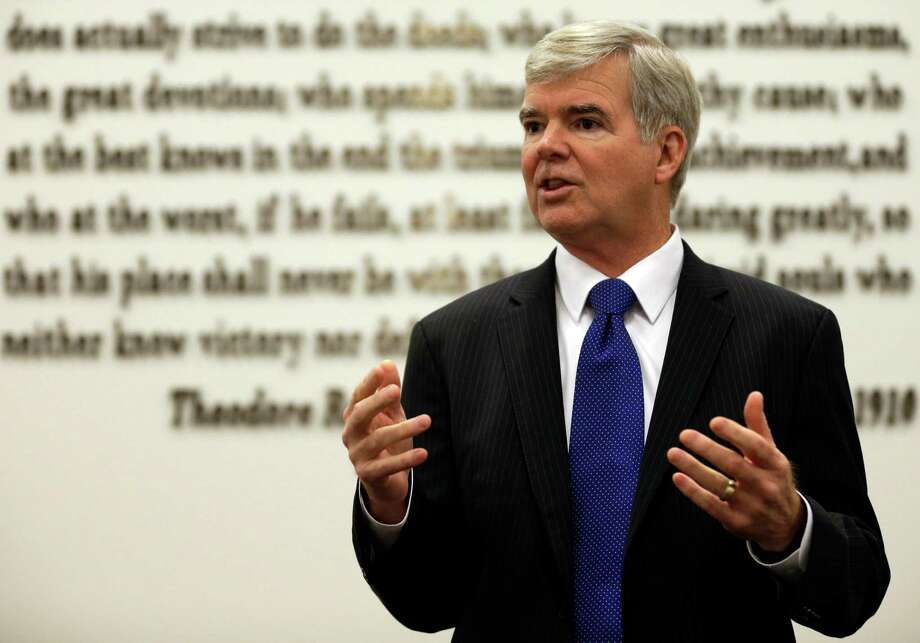 NCAA President Mark Emmert gestures while speaking at NCAA headquarters in Indianapolis, Thursday, Aug. 7, 2014. The NCAA Board of Directors overwhelmingly approved a package of historic reforms Thursday that will give the nation's five biggest conferences the ability to unilaterally change some of the basic rules governing college sports. (AP Photo/Michael Conroy) ORG XMIT: INMC102 Photo: Michael Conroy / AP