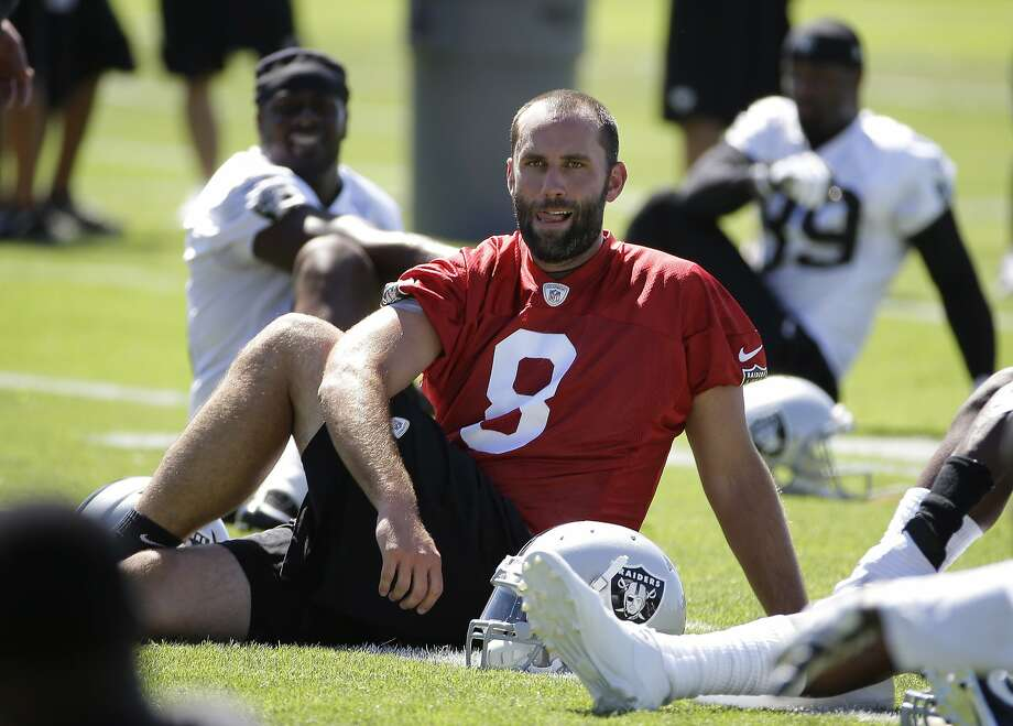 """Quarterback Matt Schaub stretches at Raiders training camp in Napa. """"I never lost my confidence or faith in my abilities"""" after struggling last year in Houston, he said. Photo: Associated Press"""
