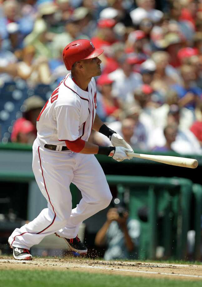 Washington Nationals' Ian Desmond watches his two-run home run during the second inning of a baseball game against the New York Mets, Thursday, Aug. 7, 2014, in Washington. (AP Photo/Luis M. Alvarez) ORG XMIT: NAT103 Photo: Luis M. Alvarez / FR596 AP