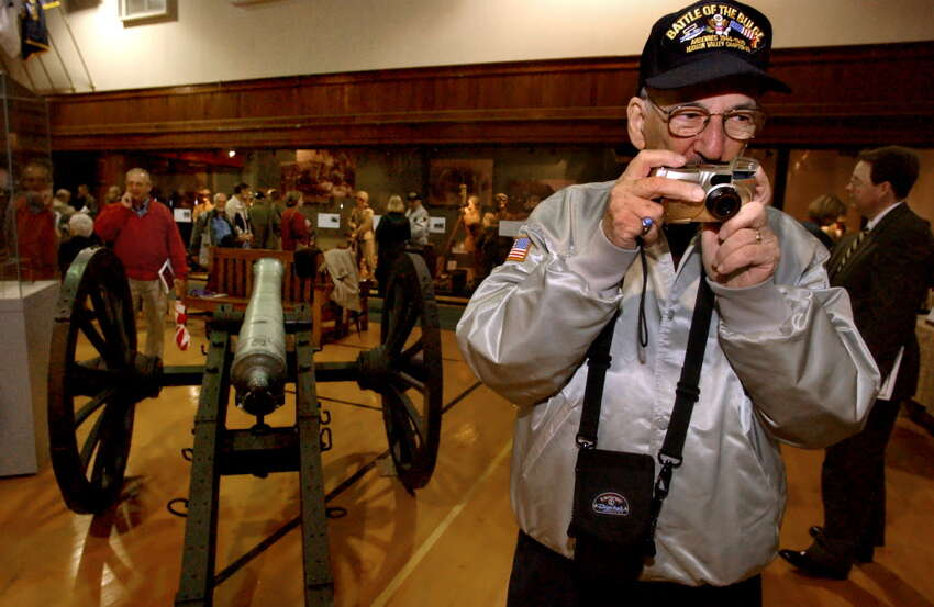 World War II veteran Richard Marowitz of Albany takes a picture of an exhibit on opening day of the state Military Museum and Veterans Research Center in 2002 in Saratoga Springs, N.Y. (Cindy Schultz/Times Union archive)